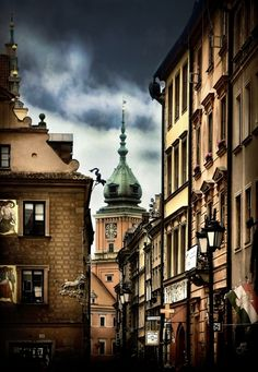Streets of old Warsaw, Poland. Warsaw is the capital and largest city of Poland. It is located on the Vistula River, roughly 160 miles from the Baltic Sea and 190 miles from the Carpathian Mountains. Photo by Viktor Korostynski Warsaw Old Town, Warsaw Poland, Marie Curie, Places To Travel, Places To See, Places Around The World, Around The Worlds, Central And Eastern Europe, Poland Travel