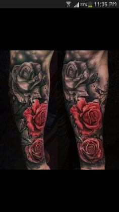 Black and grey with red roses tattoo