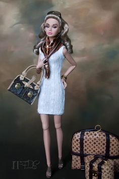 Neutral Ground Model:  The Young Sophisticate Poppy Parker Dress:  City Shopper™ Barbie® Doll – Brunette Shoes:  Mattel Purse: La Boutique Scarf: New York Yorkie™ Barbie® Accessory Pack Jewelry and Luggage:  Integrity Toys