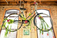 Flowers hanging on a bike?! I sure think so!!