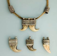 Africa | Pendants worn by the Oromo peoples of Ethiopia | Silver, lions claws and teeth | This type of pendant can also be found among the Amhara peoples of Ethiopia.  The Maharajas of India wear a similar pendant.