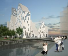 """Called 'Iceberg', the project features mixed dwellings types & commercial space. Its jagged heights allow better views toward the ocean and better daylight conditions, and the tops and bottoms are shifted so that views between the volumes become possible. This breakdown of the mass creates the potential for an """"iconic"""" building for the harbor area, and one that, due to its form, creates its own skyline within itself.  'Iceberg' in Aarhus, Denmark by CEBRA + JDS + SeARCH + Louis Paillard"""