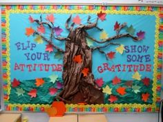 A bulletin board shows a paper tree with paper leaves attached and the words, Fl