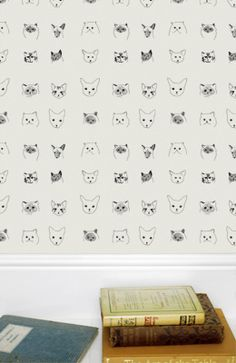 Baines&Fricker cat wallpaper, from the UK and was on Anthropologie for a while but now discontinued. Ideally in pink.