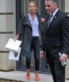 Back in the swing of things: Kelly Ripa looked downcast as she was spotted rushing out to ...