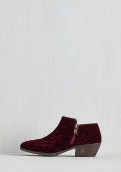 Lake Geneva Lovely Bootie in Bordeaux. Whether on a boat or in a chair along the shore, kick your feet up to get a glimpse of these rippled velvet booties amid the breathtaking panorama. #red #modcloth