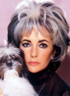 Elizabeth Taylor and her dog with matching Hair styles