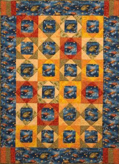 "Lexi's Turtles Lap Quilt 02 ""I made this quilt for my sister who is a lover of sea turtles, an avid boater, and diver. She picked out the blue turtle fabric, and it was my job to make it bright and tropical. I chose the square in a square, so that I could frame the turtles and use fabrics in the outer squares to pick up the colors in the turtle shells. The method I used to piece this quilt is taught by Jenny Doan of Missouri Star."""