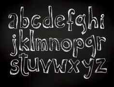 Doodle chalk drawn alphabet on a black board Stock Vector