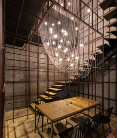 utilizing a consistent palette of exposed concrete wall, corroded steel frames, wooden tables and display boxes