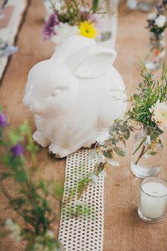 animal figurines as a centerpiece - photo by Dearheart Photos http://ruffledblog.com/handcrafted-wedding-with-a-rabbits-and-wreaths-theme #weddingideas #centerpieces
