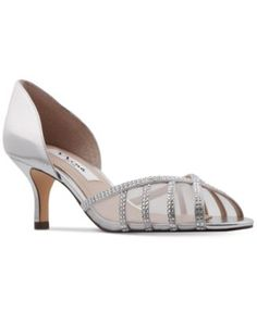 Nina Corita D'Orsay Evening Pumps $89.00 Finish an elegant evening look in the sparkling rhinestone accents and sheer mesh details on these gorgeous Corita d'Orsay pumps from Nina.