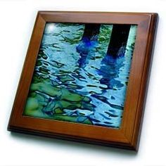"""Abstract Photo Of Caloosahatchee Blue n Green River Washing up Against The Pilings - 8x8 Framed Tile by 3dRose. $22.99. Inset high gloss 6"""" x 6"""" ceramic tile.. Dimensions: 8"""" H x 8"""" W x 1/2"""" D. Keyhole in the back of frame allows for easy hanging.. Solid wood frame. Cherry Finish. Abstract Photo Of Caloosahatchee Blue n Green River Washing up Against The Pilings Framed Tile is 8"""" x 8"""" with a 6"""" x 6"""" high gloss inset ceramic tile, surrounded by a solid wood frame with pre..."""