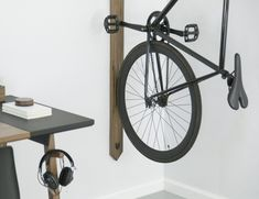 Can't think of a better way to showcase your bike while you store it indoors? With the Black Walnut Vertical Bike Rack you can actually display it with style.