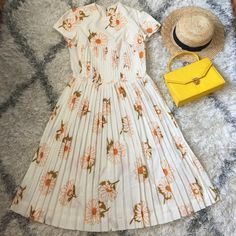 """Host Pick 8/5 Vintage daisy dress, 50's, 60's Adorable little dress! Likely from the 60's. No tags, material is thin & soft with a sleekness to it. Cute pleated bottom! Measurements, when laid flat are bust=18"""" waist=15"""". Material has little to no stretch. Zipper and 1 hook closure in the back. Purchased and never worn. Please note: zipper is slightly damaged in one area. Top seam near left shoulder is coming undone- easy fix. Price has been modified to reflect this.  *accessories not…"""