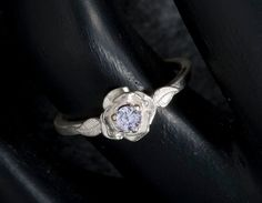 White Sapphire Engagement Ring by janeysjewels on Etsy. So gorgeous! (: $95