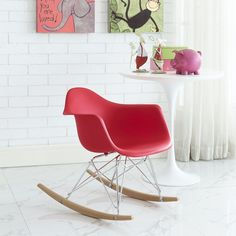 Rocker Kids Chair, Red - Train them young with the kid version of the iconic Rocker Lounge Chair. Seeing kids importune some thrilling moments on the adult version, we knew it was time to bring one of the wonders of the furniture world down a few candles on the birthday cake. This stylish kid version features the much beloved organic plastic seat form, solid stainless steel frame, and wood rocker base, shrunk down to size so that kids can be kids on the kid version; and adults can remain…