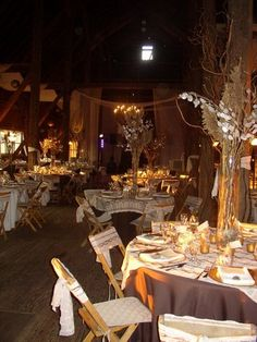 rustic reception centerpiece wheat. I really like the Reed Grass. Might add some red lilies and yellow sprays