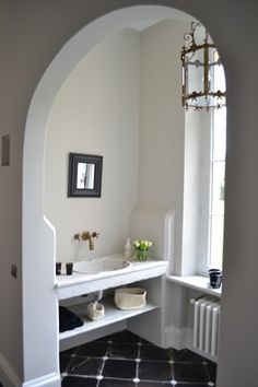 .really like the dark floor with the touches of white, the lantern , faucet, I find the mirror choice interesting, but would choose larger for my own personal taste and convenience.