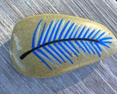 Feather. Painted rock.