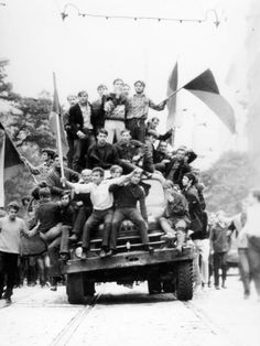Demontrators riding down the streets of Prague during what history knows as the Prague Spring in 1968.