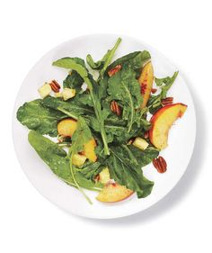 Arugula, Peach, and Cheddar Salad | Headed to a picnic or holiday cookout? Delight your fellow revelers with one of these delicious (and totally goof-proof) seasonal side dishes.