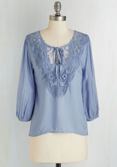 Lifelong Romantic Top in Blue. For as long as you can remember, youve swooned over all things sweet, like the whispering blue-grey hue and flowing 3/4 sleeves of this blouse. #blue #modcloth