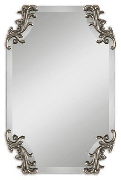 Uttermost Andretta Baruque Silver Mirror Frameless, shaped beveled mirror accented by decorative corner ornaments finished in heavily burnished antiqued silver. May be hung either horizontal or vertical Uttermost's mirrors combine premium quality materials with unique high-style design.