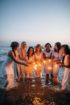 Pre-wedding photo shoot on the beach with your maids + some sparklers. Photography: Bethany Small Photography - www.bethanysmall.com Read More: http://www.stylemepretty.com/2014/07/07/seaside-chic-bridal-party-tea-party/