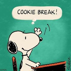 Cookie break! Snoopy raising his paw sitting at a school desk.