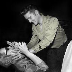 Vampira gets assaulted by Elvis Presley, Las Vegas, May 1956.