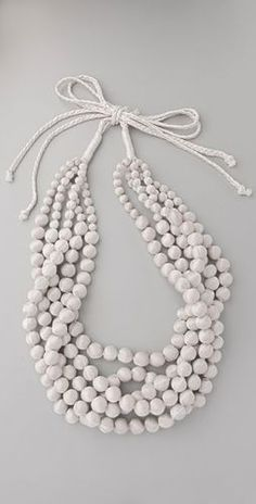 Love this white beaded necklace!