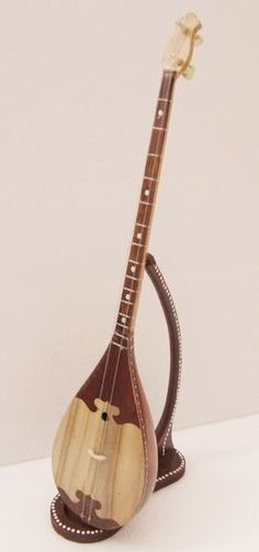 The Dongbula is a stringed musical instrument of the Kazak ethnicity in ancient China. (or is it a 2 string bass?) =standing in for ==Lardys Chordophone of the day - 2 years ago --- https://www.pinterest.com/lardyfatboy/