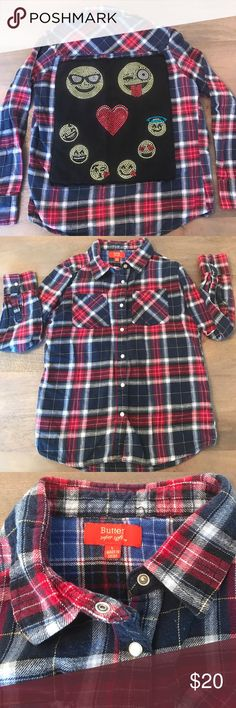 😍 Butter Brand emoji flannel shirt 😍 Girl's emoji flannel long sleeve shirt. Adorned with beautiful sparkly emojis on the back and pearl snaps down the front. Navy, red and white. Size L, fits like a girl's 10. One emoji is missing a couple stones as shown in the last pic. Butter Shirts & Tops Button Down Shirts