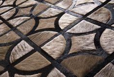 Circle-cross cow hide rug