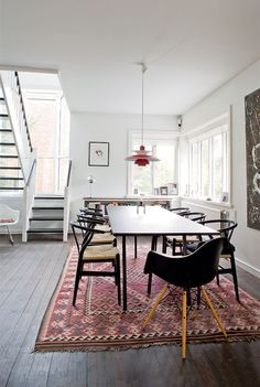 Can't resist a white dining room with a big patterned rug!
