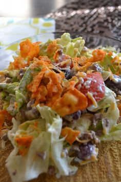Taco Salad topped with Crunched Up Doritos  was it seven layer or something like that? Had Doritos or growing up the fake ones