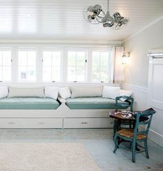 Beach house day beds with built-in storage underneath.
