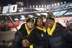 Athletes from Jamaica's delegation take a selfie as they parade during the opening ceremony of the Pyeongchang 2018 Winter Olympic Games at the Pyeongchang Stadium on February 9, 2018.