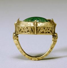 This elaborate bishop's ring has the typical combination of a gold setting with a single, large stone, in this case malachite. 13th century..............