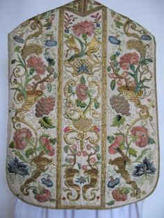 """The beautiful embroidery, in brightly coloured silk and gold thread, is of moss roses, carnations and grapes riding from cornucopia. It was remounted by Br. Houghton in 1850. """"I hope"""" he writes, """"it will last a long time to the honour and praise of Our Lord""""."""