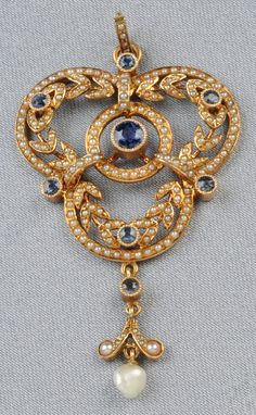 Edwardian 14kt Gold Gem-set Pendant, designed as a trefoil set with circular-cut sapphires and seed pearls, suspending a drop, lg. 2 1/8 in., together with a 14kt gold chain.