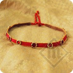 medieval Made of red, tablet-woven braid adorned with brass, enameled mounts. Finished with soft leather on the inside. Medieval Hats, Medieval Life, Medieval Costume, Historical Hairstyles, Medieval Hairstyles, 14th Century Clothing, Medieval Dress Pattern, Viking Clothing, Tablet Weaving