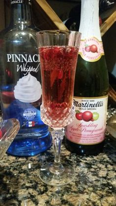 Big hit signature cocktail at the party last night: 1 tsp pomegranate seeds, 1 oz. Pinnacle Whipped Cream vodka, fill champage flute 1/2 to 2/3 with Martinellis apple - pomegranate sparkling cider, top with club soda.