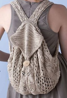 Knitting Pattern for Commuter Knapsack - This lace and mesh back with leaf motifs and cable straps features a drawstring opening and a flap with a button closure. Designed by Deborah Newton, this one of the 22 patterns in Knitting Green: Conversations and Planet Friendly Projects