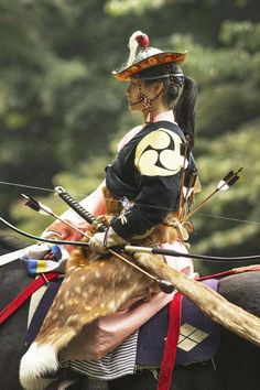 A young woman in traditional Samurai garb. The status of samurai as predominately horse archers has been overlooked, in part due to the media obsession with the Tokugawa period. Much like the plate armoured knight in European history, the era of the courtly swordsman is actually just a small moment in time in the history of the Samurai. On horseback with a bow would be the more consistent portrait if taking into account the full sweeping history of the warrior caste of Japan.