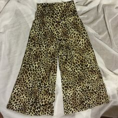 Leopard Prints Pants Leopard Print Pants These pants are the cats meow with this cute all over print. Throw on your favorite black crop top and heels for a chic edgy fun look. Zac & Rachel Pants Wide Leg