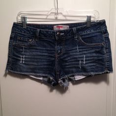 Dark wash, distressed jean shorts Dark wash, distressed jean shorts. Almost would classify them as daisy dukes - the bottom of the pockets do stick out a bit in the front. Very cute ☀️ T Five Denim Shorts Jean Shorts