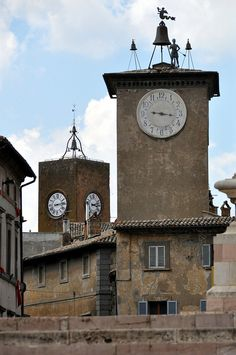 Two medieval towers from Piazza del Duomo in Orvieto, Italy: On the left, Torre del Moro; and on the right, Torre di Maurizio.