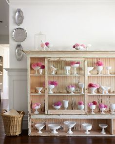 The owner of this California home shows off her milk glass in a general-store display case standing in one of the hallways.